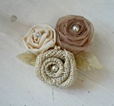 Handmade Fabric Rosette Flowers - Ivory Burlap, Cream Fabric, Champagne Organza, Gold Leaves - Wedding Corsage, Cake Topper, Hair Accessory. $26.00, via Etsy.