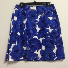 "BRIGGS Skirt SZ 12 Blue, purple and white floral. Excellent condition. 97% Cotton and 3% Spandex, 20""L, has 5"" slit on one side and zips on the back. Briggs Skirts Midi"