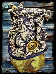Baker Street Burlep Topper - Steampunk, Victorian-inspired Chocolate Brown Print with Ribbon and Button Trim. $145.95, via Etsy.