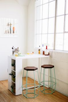 A mini bar with the coolest stools ever