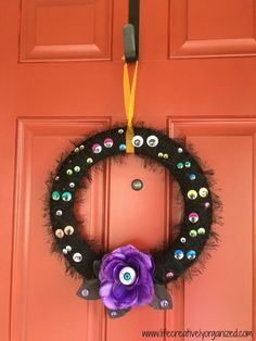 Looking for an easy and inexpensive DIY Halloween wreath that's sure to add a spooky touch to your front door? I used 2 wire frames from the dollar store, a sk… (dollar store fall crafts for kids) Halloween Crafts For Toddlers, Fall Crafts For Kids, Holiday Crafts, Holiday Decor, Halloween Eyeballs, Halloween Candy, Fall Halloween, Halloween Ideas, Wreath Crafts