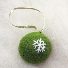 felted ball ornament - then needlefelt decoration on it... maybe put bell inside?