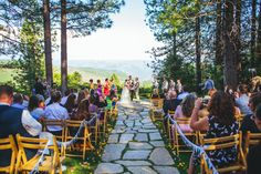This mountaintop ceremony view is breathtaking!  (Colorful Foresthill Wedding)