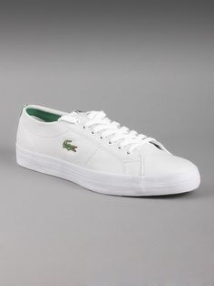 Lacoste Mens Marcel Chunky CRE Leather Shoes in White. Casual  style to slip into for strolls along the beach, or on the boardwalk!  These white leather shoes feature the green Lacoste croc logo  embroidered on the side, a low-profile look, and a white synthetic  midsole with a navy outsole.