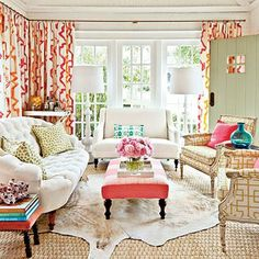 Mix Instead of Match Fabrics | The designer started with fabric selections to set the room's happy mood and a bright color palette of pink, turquoise, and chartreuse. Fabrics don't have to be matchy-matchy to communicate with each other. If they share a similar vibrancy and color temperature, they'll look good together. | SouthernLIving.com