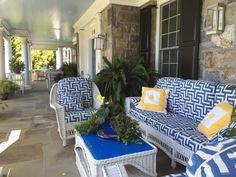 Lovely front porch featuring Boyd Lighting's Phantom Sconce, designed by Sherry Williamson of Brayton Hughes Design.