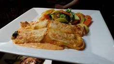 2/28 Special Canneloni di Pollo-  Homemade crepes stuffed with spinach, mushrooms, feta cheese, caramelized onions and chicken baked in a rose sauce served with vedure di giorno