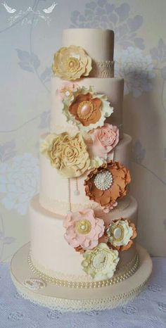 Corsages wedding cake Romeo & Juliet Cakes cameo, pearls, lace, crochet,jewels, ruffles