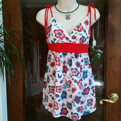 Wet Seal Floral Top Size L Very pretty Top from Wet Seal. Pre-loved great condition.  Size L  100% Rayon Wet Seal Tops