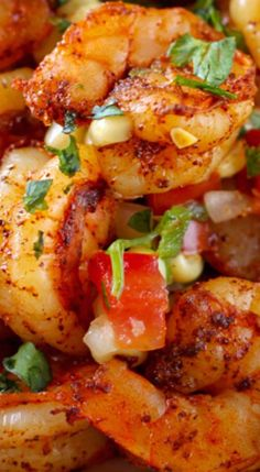 This Mexican Grilled Shrimp with Corn Salsa is one of my new favorite dinners! These flavorful little shrimp are absolutely delicious  on their own with a side o