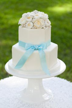 Simple, classic wedding cake. Love those flowers on top!