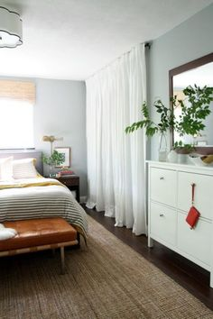 Louvered or sliding doors often just get in the way. A curtain gives bulkier pieces room to breath, is easier to open and reach past, and offers a relaxed look to a bedroom.