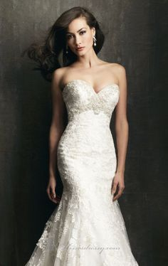 Love every bit of glamour in 9051 by Allure Bridals. This exciting wedding gown features a strapless and striking sweetheart neckline. Embellishing the bodice is the precious Swarovski crystals. The entire silhouette is covered with delicate lace applique in English net, and leads a mermaid shape with train to accentuate your contour.