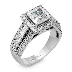 This contemporary setting is made for a princess cut center stone, surrounding it with .54 ctw of round diamonds and .46 ctw of princess cut side diamonds.