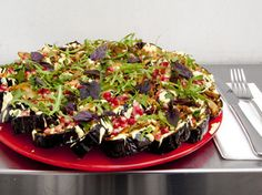 Roasted aubergine with date yoghurt, pickled lemon, pistachio and basil | Ottolenghi via Time Out