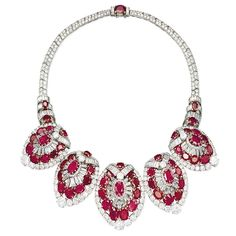 Ruby and diamond parure belonging to Lady Lydia Deterding (the wife of Sir Henri Deterding, the founder of Royal Dutch Petroleum), made to order by Cartier Paris, France, 1950. The parure consists of a necklace that has five detachable sections to be worn as clips, a bangle and a pair of earrings.The rubies are all certified those of the Burma Mogok mine.