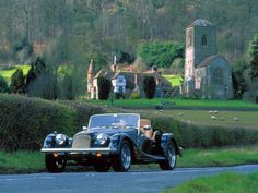 A drive in the English countryside on a summer's afternoon in a vintage Morgan.  Were off to visit the rest of England.........