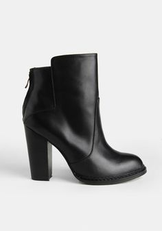 Sometimes you just need a good old plain black leather bootie. Maybe you think you are covered because you have one in your closet from a few years ago...but take a look. Does it have a skinny heel? If you want to look up to date then trade it in for one like this with a stacked heel.