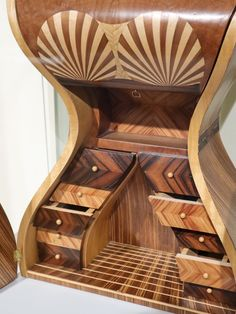 """A chest of drawers inside a chest. Mixed solid timber and veneer marquetry to form an array of hidden drawers and compartments. Note the key located under the """"sternum"""" that will release the bust to unhinge downwards. Rope Maker, Visit Tour, Copper And Brass, Marquetry, Cabinet Makers, Chest Of Drawers, Blacksmithing, Note, Key"""