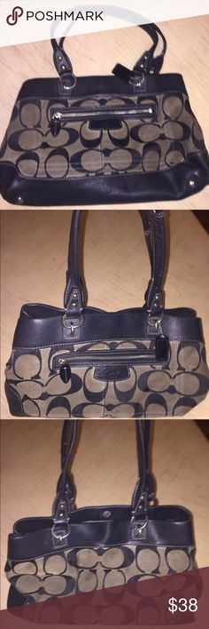 Used Grey & Black Authentic Coach Purse Used Grey & Black Authentic Coach Purse. Outside Needs to be Cleaned, Has Discoloration & A Stain. Insides Pretty Clean. Lots of Pockets & Room. More Pics Upon Request. Open to Offers. Coach Bags
