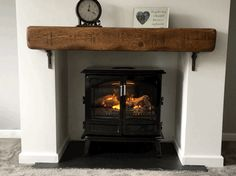 Dimplex Optimyst Grand Noir fire with oak beam mantle on slate hearth