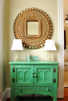 love the painted sideboard and twin lamps & round framed mirror. SO cute
