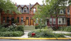 Ornate brick homes in the Pullman neighborhood, built in the 1800s by industrialist George Pullman as a blue-collar utopia to house workers from his sleeping-railcar factory in Chicago, are seen Friday, Aug. 22, 2014.