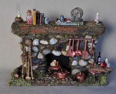 Fairy House Fireplace  made from simple wood fireplace from Hobby Lobby.... Beautiful!!