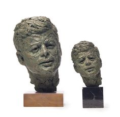 Two patinated plaster busts of John F. Kennedy.