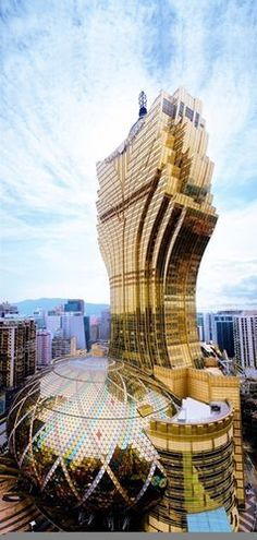 Grand Lisboa - Hotel in Macau, owned by Sociedade de Turismo e Diversões de Macau and designed by Hong Kong architects Dennis Lau and Ng Chun Man.