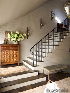 This staircase echoes Shaker design: Its railing is unadorned except for the lamb's tongue that connects to the newel post.