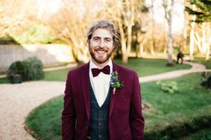 Burgundy Wedding Suit with Bow Tie and Buttonhole | By Jason Williams Photography | Winter Wedding | Burgundy Wedding Suit | Crazy Bear Wedding | Bridal Jacket | Bridal Leather Jacket | Green Bridesmaid Dresses Groomsmen Outfits, Groom Outfit, Green Bridesmaid Dresses, Bridesmaid Outfit, Bow Tie Suit, Jason Williams, Burgundy Suit, Morning Suits, Bear Wedding