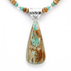 This beautiful sterling silver pendant features Boulder Turquoise found in the original Royston Mines, near Tonapah, Nevada. Created by Navajo jewelers and Navajo silversmiths.