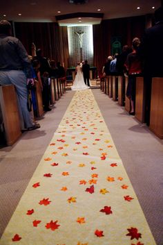 Fall/Autumn Wedding Decoration for a church wedding - So pretty! - Love the leaves on the runner!