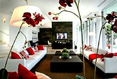 My trendy family room with red to accent.