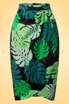 """44,95 € / This 50s Kala Tahiti Palm Sarong Skirtis a striking skirt inspired by the Tiki Sarong skirts from the fifties!This tropical beauty will surely brighten any day!Made from a light stretchy, cotton blend with a striking green print for a perfect fit. Wear her to the beach on a sunny day or team with high heels for a night out, it's always Kala time!   Fixed wrap over Pleats Zipper at the back Hits the knee with a height of 1.70m / 5'7"""" The featured top and earrings are not ava..."""