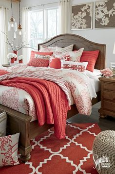 #AshleyFurniture - Color your world with shades of coral, white and tan! What a beautiful color combo for the bedroom! Coral and white bedding, rugs, pillows, accessories and neutral wall art, lamps and poufs. So pretty! Ashley Furniture - Color Your World - Home Color Ideas - Bedroom Coral Ideas
