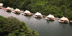 The 4 Rivers Floating Eco Lodge in Cambodia is unlike any place you´ve stayed before. The environmentally friendly resort has 12 stylish water bungalows, guests can kayak to the waterfall, have hiking tours through the forest, massages, bathe in natu Honeymoon Getaways, Honeymoon Destinations, Honeymoon Packages, Vacations, Bed And Breakfast, Budget Friendly Honeymoons, Go Glamping, Overwater Bungalows, River Lodge