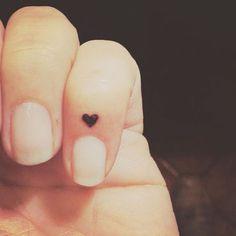 Love this simple tiny heart finger tattoo idea.