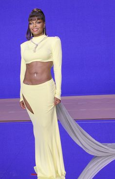 """Angelic from Janet Jackson's Best Looks From Red Carpet to Concerts  The Queen of Abs continued her reign at the """"Call on Me"""" music video shoot in 2006."""