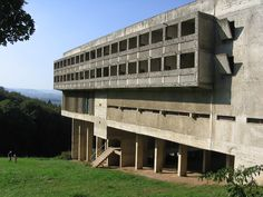 Sainte Marie de La Tourette is a Dominican Order priory, located on a hillside near Lyon, designed by Le Corbusier, the architect's final building. The design of the building begun in May 1953 and was completed in 1961. Though still functioning for a reduced population of friars, La Tourette has become something of a pilgrimage site for students and lovers of architecture. The priory allows overnight stays in unused cells with fees for the room going to the maintenance of the priory. Le Corbusier, Switzerland Places To Visit, Switzerland Vacation, Casa Farnsworth, Villa Savoye, Brutalist Buildings, Culture Art, Chandigarh, Sainte Marie