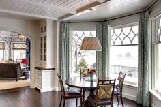 A large projecting bay window in the breakfast nook creates an ideal space for casual dining with panoramic water views.