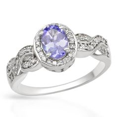 Bring a touch of class to your jewelry box with this sterling silver ring, available during a special liquidation. The ring features an oval, blue-violet tanzanite surrounded by white, round diamonds.