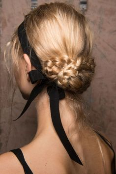 Try a romantic braided updo for your next formal event. For extra charm, add a simple black ribbon and tie a bow at the nape of your neck.