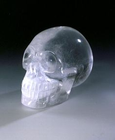 """Skulls made from crystal and gems are among the most astonishing artefacts ever discovered. They seem surprisingly modern and naturalistic. Little is known of their origins, the methods with which they were made, and their age. """"E.T"""" stands in the centre - a bizarre head from smoke quartz which was discovered in Guatemala in 1908. Scientists have proven that it is at least 500 years old. It was precisely worked by manual grinding and polishing."""