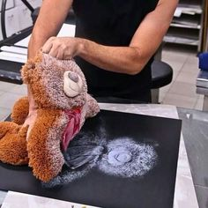 Save the memory! Before getting rid of an old favorite stuffed toy, remove the stuffing, Dip the front if the toy in white and press to a dark poster board. Instant memory you can frame.