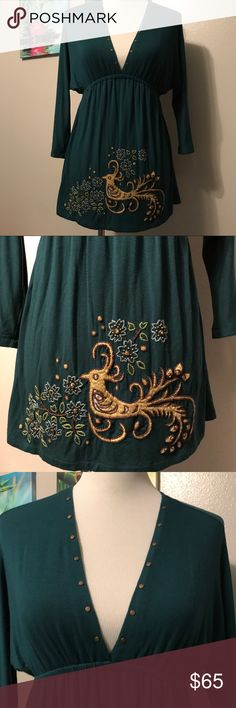 Luxurious Material Soul Revival Turquoise V-neck One of a kind hand embroidered blouse by Soul Revival size small. So incredibly soft and luxurious. Turquoise green blue color with a beautiful bird. You are sure to turn heads in this stunning blouse. Soul Revival Tops Tunics