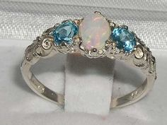 Ladies Solid White 10K Gold Natural Opal & Blue Topaz English Victorian Trilogy Ring – Size 8.25 – Finger Sizes 5 to 12 Available – Ideal gift for Valentines, Mothers Day, Birthday, Christmas, Thanksgiving, Graduation, Confirmation, Easter http://www.easterdepot.com/ladies-solid-white-10k-gold-natural-opal-blue-topaz-english-victorian-trilogy-ring-size-8-25-finger-sizes-5-to-12-available-ideal-gift-for-valentines-mothers-day-birthday-christmas-tha/ #easter  One centre oval cut 6×4 mm..