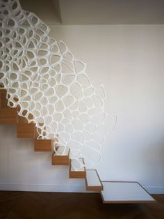 Organic corian balustrade and corian treads. Love the treads starting thin at the base and getting deeper up the flight. By Marc Fornes and theverymany, photos by Christian Richters