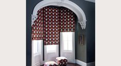 The pattern is terrible, but this is what roman shades in that space could look like.